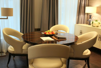 Table and chairs in a hotel room at the Corinthia Hotel in London England