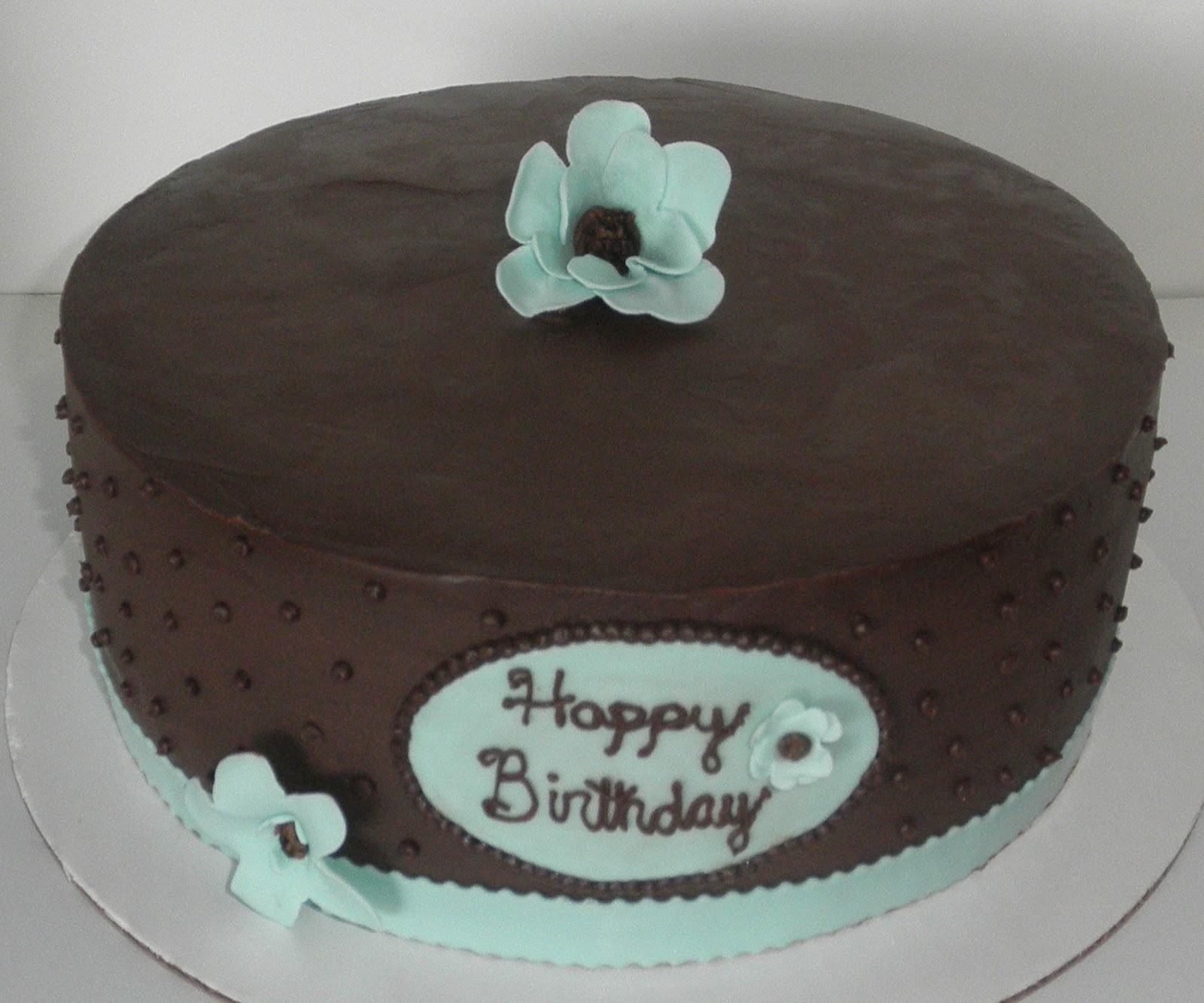 Sweet ts cake design light blue flowers w brown centers light blue flowers w brown centers chocolate ganache w pastry cream birthday cake izmirmasajfo