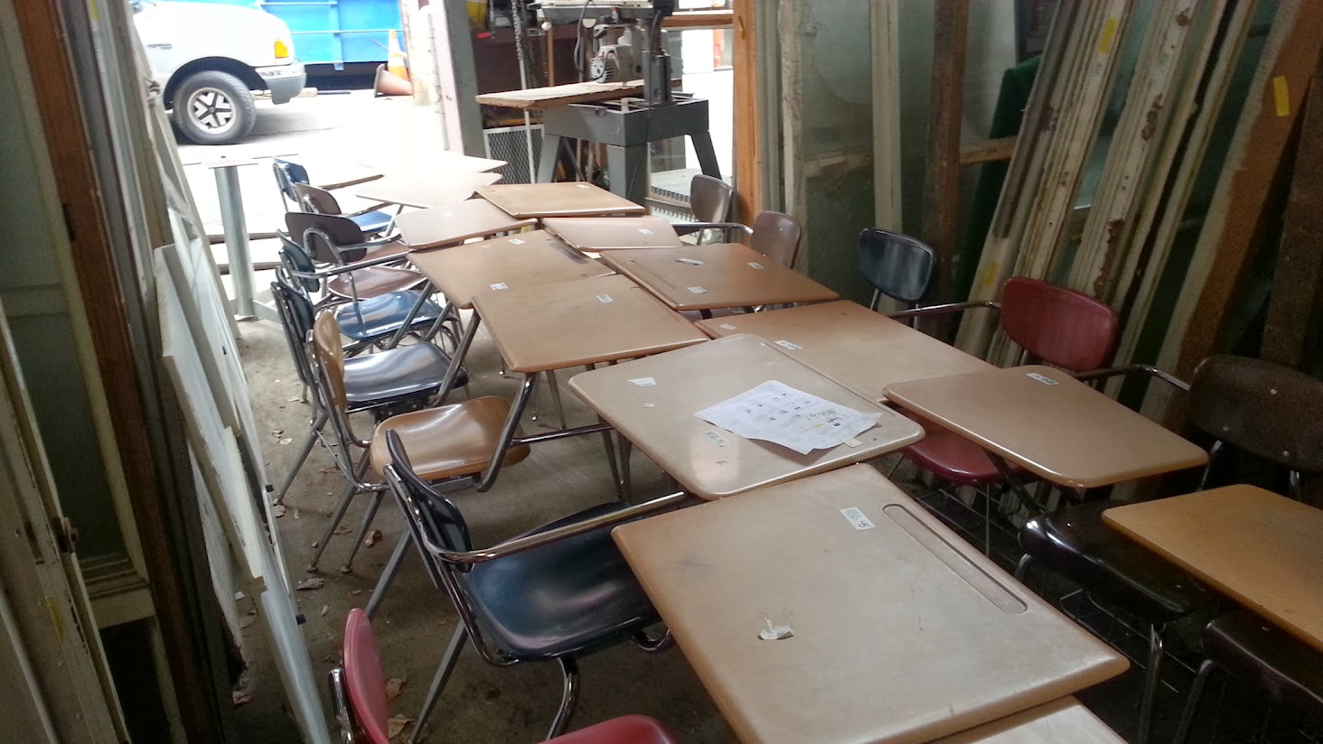 Twenty or so used school desks for sale at the Rebuilding Center
