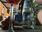 My artful (drunk) picture of Larry through the wineglasses