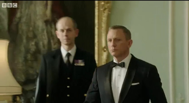 James Bond Escorting The Queen