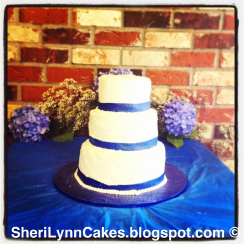 Sheri Lynns Cakes White Wedding Cake With Royal Blue Ribbon