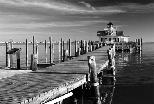 """""""Roanoke Marshes Lighthouse"""" by Photographer Greg Kluempers."""