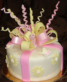 Pink and yellow sugar bows fondant birthday cake with butterflies and daisies
