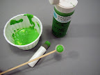 Slightly water down green paint (I like the Martha Stewart Crafts paint because it adheres to all surfaces permanently). Using a mini foam pouncer, pounce on pearl.
