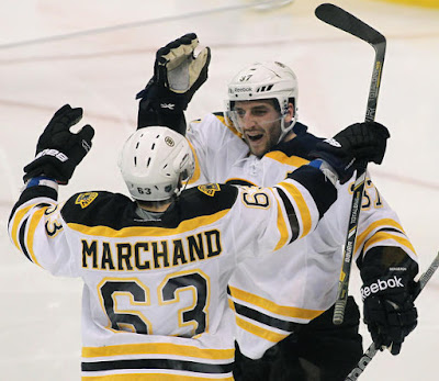 Patrice Bergeron and Brad Marchand celebrate Marchand's goal