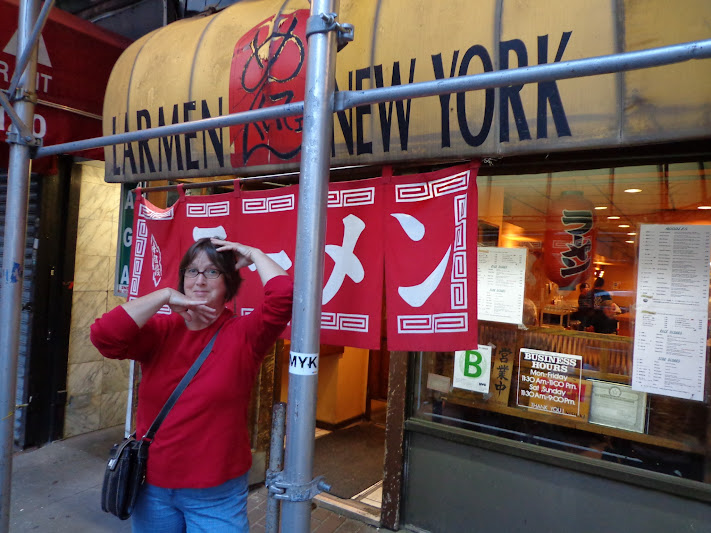 image of B in front of a New York City ramen shop