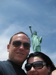 Attempt #1 at a self-shot of us and the statue.  Here, Mila has a Statue of Liberty-like growth coming out of her head.