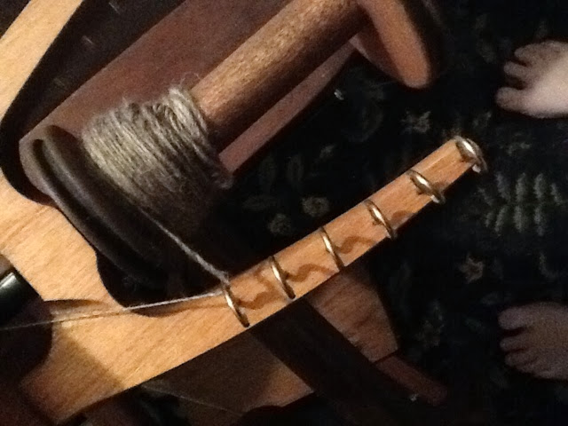 spinning bfl wool on spinning wheel