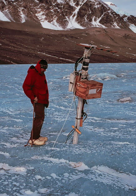 Chris Fritsen examines the weather station on East Lake Bonney, 1996.