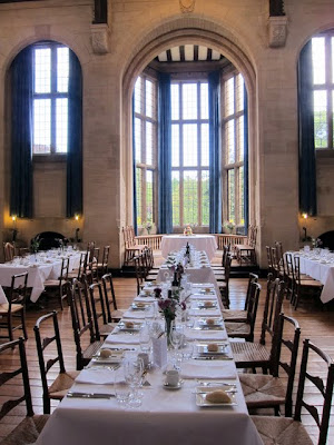 Dining tables at Rhodes House set for a wedding in Oxford England