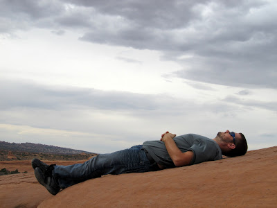 Chris resting near Delicate Arch