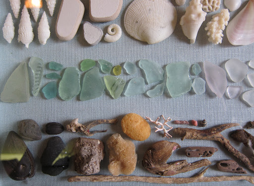 I arranged the sea glass to fade from pale green to white.