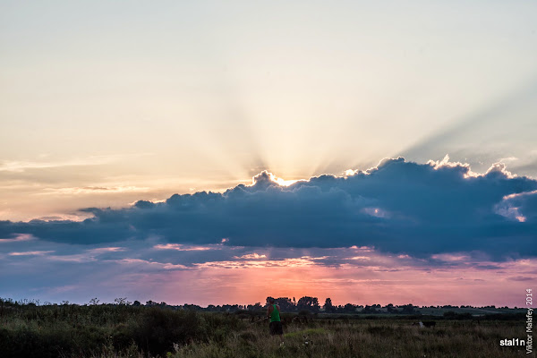 Захід сонця за хмарами