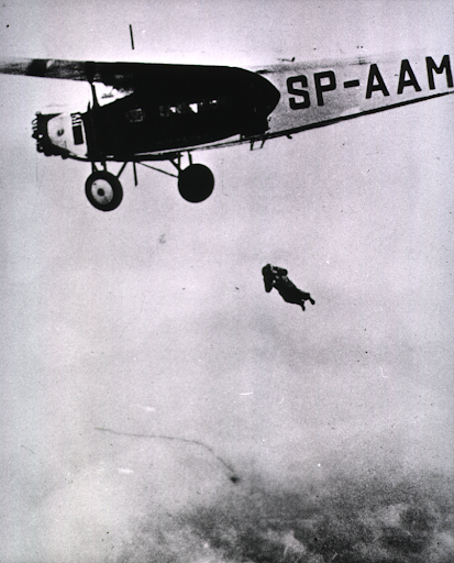 A nurse parachutist, having jumped, is about to open her parachute.