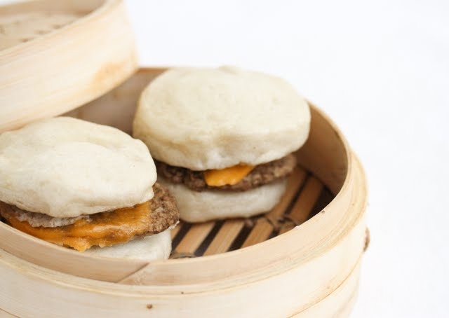 photo of two sausage sandwiches in a bamboo steamer