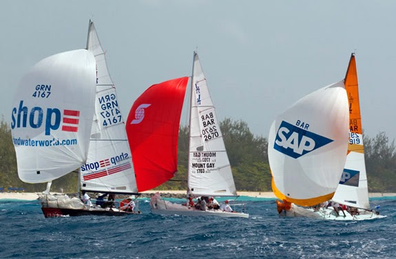 J/24s sailing under colorful spinnakers off Barbados