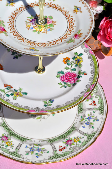 Mismatched china cake stand in pink and green florals