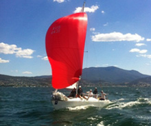 J/24 one-design sailboat- sailing fast downwind