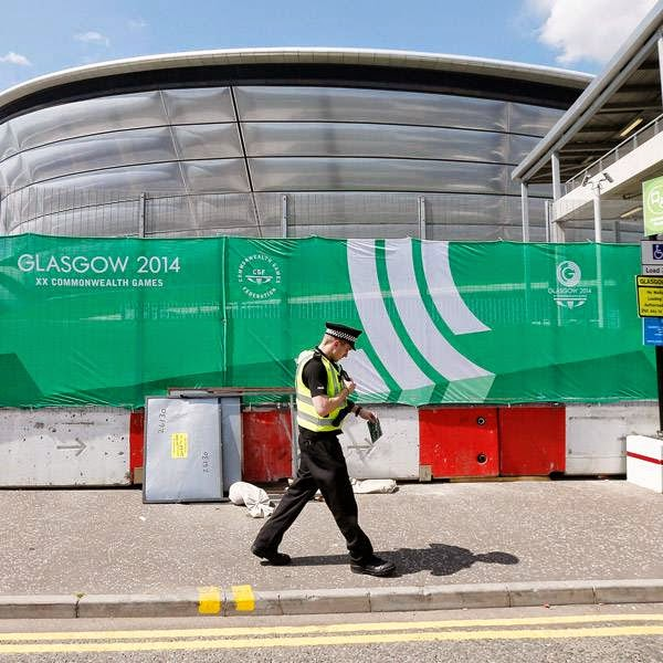 A police officer walks past the security perimeter of the SSE Hydro in Glasgow, Scotland, July 22, 2014.