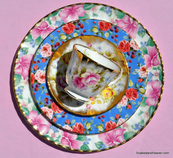 Pink, blue, red and gold themed vintage china teacup top cake stand