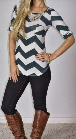 Black jeans, long boots, zig zag style blouse and necklace