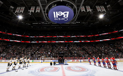 Bruins and Canadiens players lined up at Bell Centre during national anthems