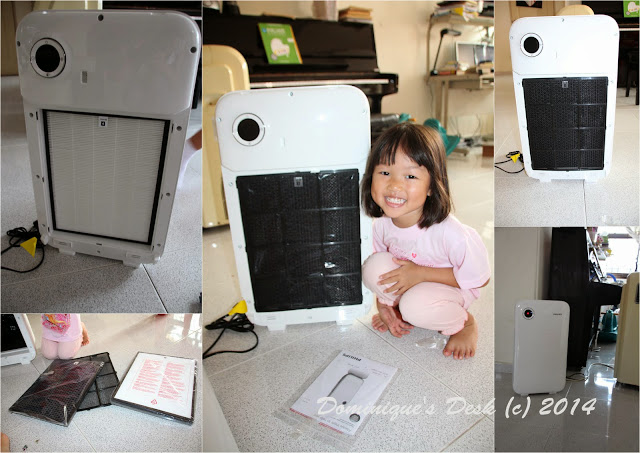 Tiger girl showing the inside of the Philips Air Purifier