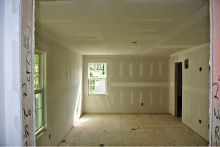 Picture of the master bedroom as viewed from the master bathroom with drywall installed
