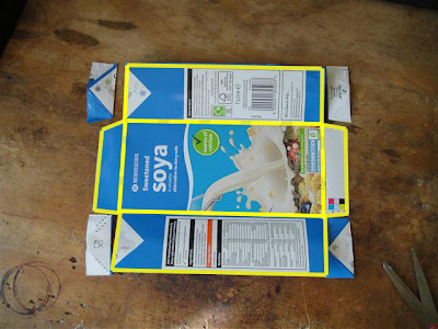 Save the yellow bits. The carton already has all of the folds you need.