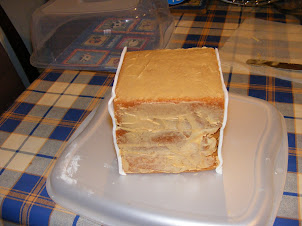 Cake covered in spread and iced on two sides