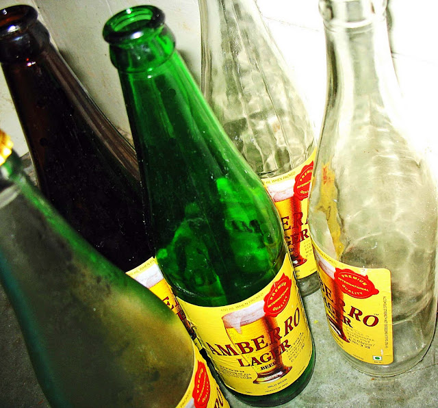 empty beer bottles different colours