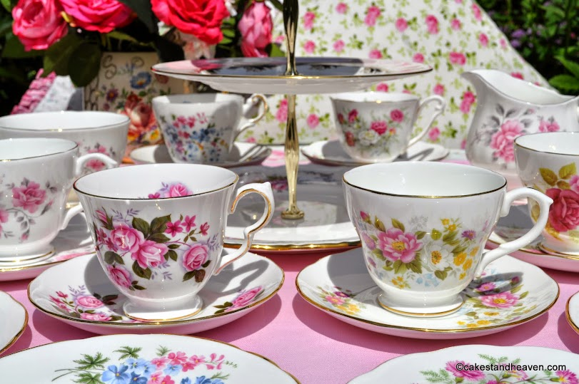 pink floral mismatched vintage tea set for six with teacup top cake stand