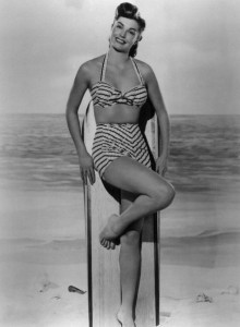 6f061dddfb2 I've come to believe that the most flattering two-piece bathing suit is one  cut much like the suit Esther is wearing above. It's also the shape of  these ...