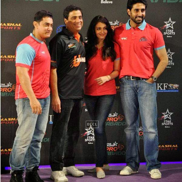 (L to R)Aamir Khan, Ronnie Screwvala, Aishwarya Rai Bachchan and Abhishek Bachchan during the opening match of Pro-Kabbadi League, held in Mumbai, on July 26, 2014. (Pic: Viral Bhayani)