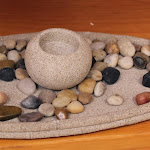 Natural objects, beautifully displayed, call children to work with them. Don't you feel like you'd like to be able to touch these pebbles?!