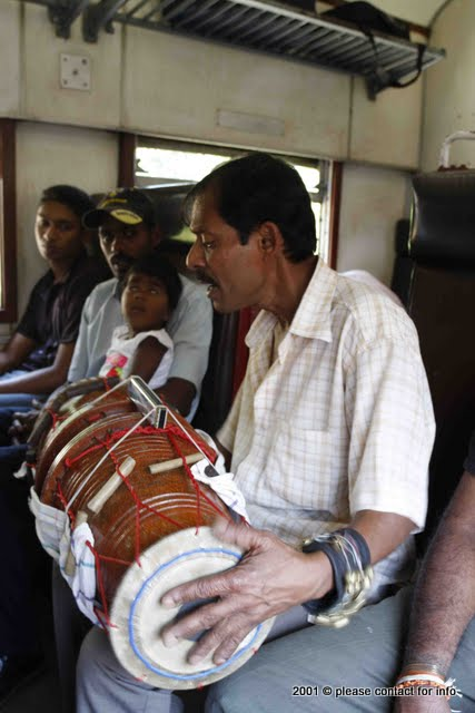 Sri Lankan street singer in the train