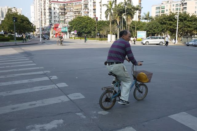man on a small bike in Zhuhai, China