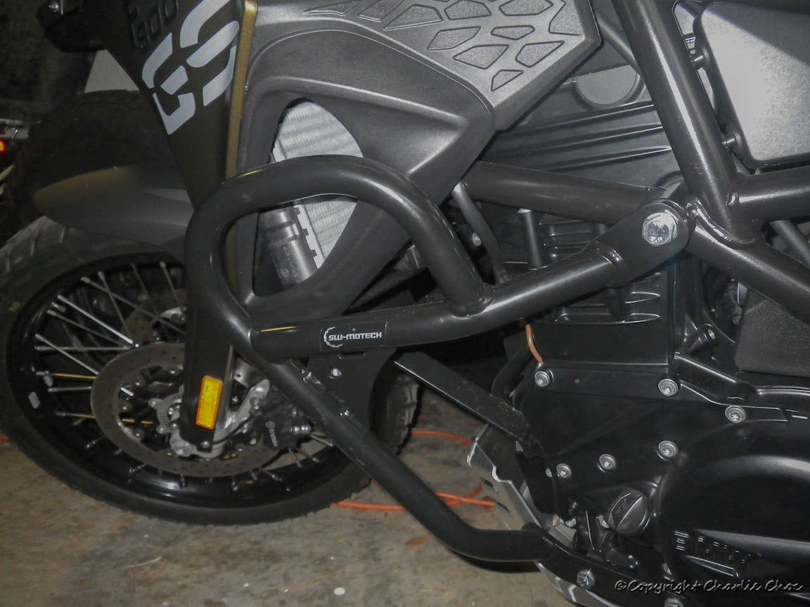 My dealer mounted sw motech crashbars on my 2013 f800gs and they don t make contact with the plastic on either side there is a fairly thick washer between