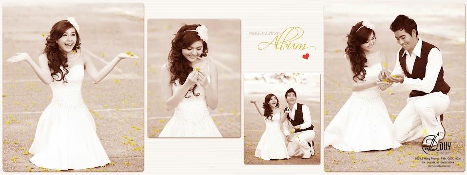 Hoa vàng rơi tạo nên không gian lãng mạn trong album hình cưới đẹp phố hoa mùa xuân