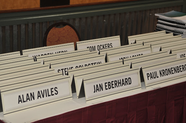 Name plates awaiting their owners before the conference.
