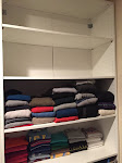 AFTER:  T-shirts in a much more manageable quantity; Sweaters too and also organized by function and weight.