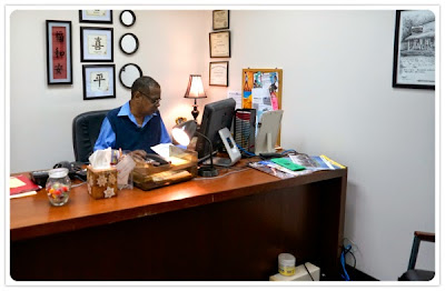 MCIL staff member working at his desk