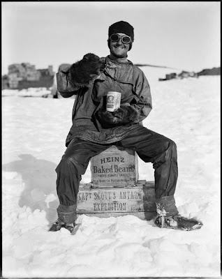 A member of the team tucks into a tin of Heinz baked beans in the Ross Dependency, during Captain Robert Falcon Scott's Terra Nova Expedition to the Antarctic, January 1912. (Photo by Herbert Ponting/Scott Polar Research Institute, University of Cambridge/Getty Images)
