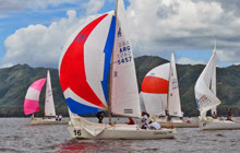 J/24s sailing on Lago San Roque in Cordoba, Argentina