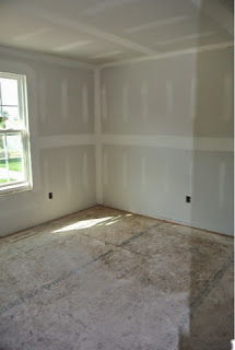 Picture of Ryan Homes Florence Model bedroom 2 view from the hallway with drywall installed