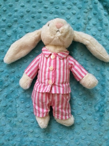 Bunny soft toy in pink and white striped pjs