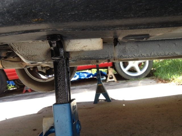 After Lifting High Enough   Then Jack Stands Were Inserted Under Pinch Weld  Spots To Secure Car In Place.