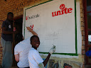 Ulusaba asked us (i.e. the Art Club) to paint the sponsorship sign for the new library, so Georg and Enock and a couple other boys helped and I was also lucky to have Robin (one of the new PCVs replacing us) help out a bit!