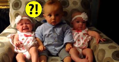 Bebé adoravelmente confuso ao conhecer gémeas fofas